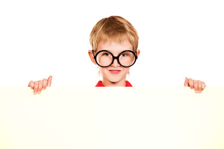 Portrait of a smiling schoolkid in spectacles behind white board. Isolated over white . photo