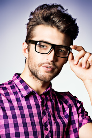 Portrait of a modern young man in spectacles. photo