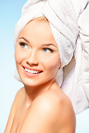 Portrait of a happy beautiful blonde woman after bath smiling at camera. Body care. photo