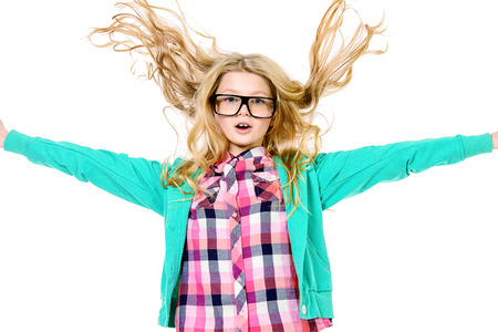 Emotional ten years girl in big glasses. Education. Isolated over white. photo