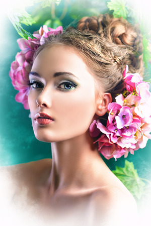 Beautiful girl with flowers in her hair. Spring. Stock Photo - 25104004