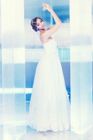 Full length portrait of a beautiful charming bride.  Stock Photo