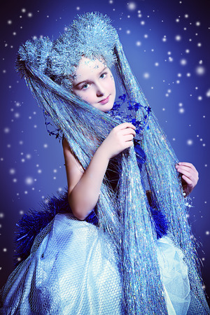 Portrait of a beautiful girl who looks like a little snow Queen. photo