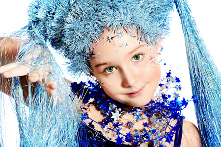 Portrait of a beautiful girl who looks like a little snow Queen. Isolated over white. photo