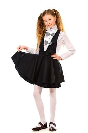 schoolgirl uniform: Portrait of a ten years schoolgirl wearing uniform. Isolated over white.