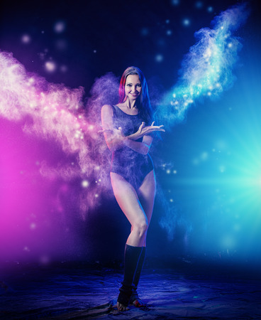Beautiful expressive bellet dancer dancing at studio. Powder Photo Shoot. photo