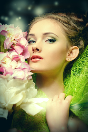 Portrait of a beautiful girl with flowers. Spring. photo