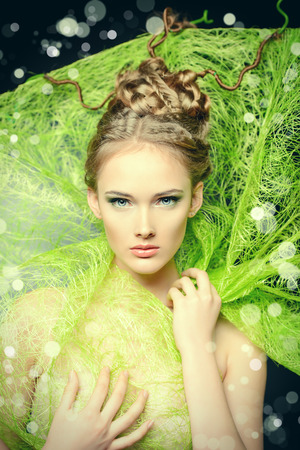 stunning: Fashion shot of a stunning female model with beautiful hairstyle. Spring beauty.