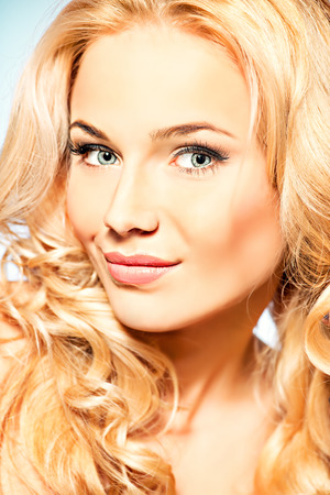 Portrait of a happy beautiful blonde woman smiling at camera. Body care. Spa. photo