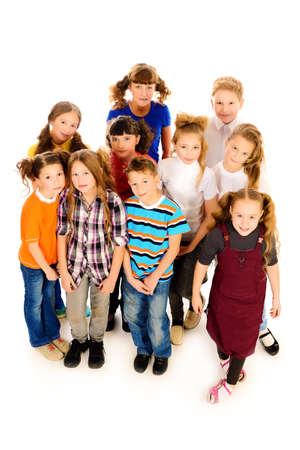 Group of happy children standing together. Isolated over white. photo