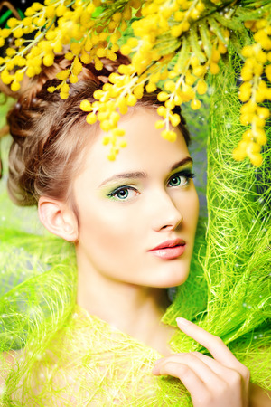 mimosa: Portrait of a beautiful girl with mimosa flowers. Spring. Stock Photo