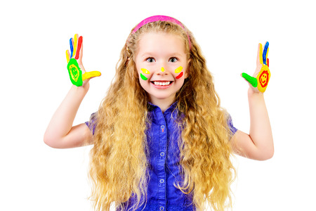 Laughing little girl painted in bright colors. Happy childhood. Isolated over white. photo