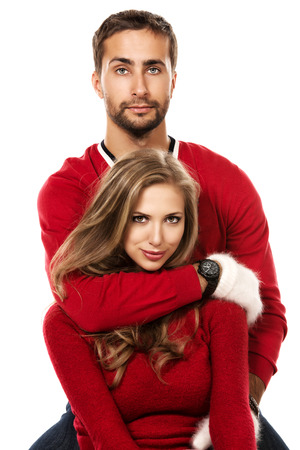 woman sweater: Happy young couple in warm winter clothing. Isolated over white.