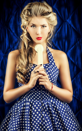 Charming pin-up woman with retro hairstyle and make-up. photo