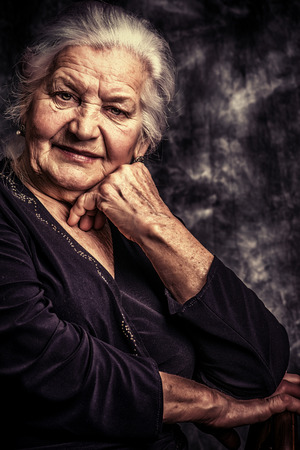 wise woman: Portrait of a beautiful smiling senior woman.