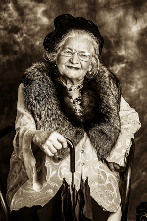 madam: Portrait of a beautiful old lady in an elegant old-fashioned clothes Stock Photo