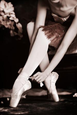 Beautiful bellet dancer posing at studio over vintage background   photo