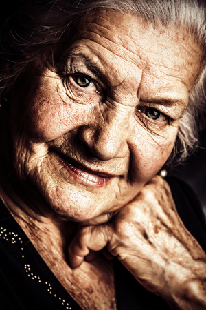 wise woman: Portrait of a beautiful smiling senior woman