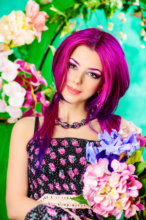 Portrait of a attractive girl among the flowers. Spring. Summer. photo