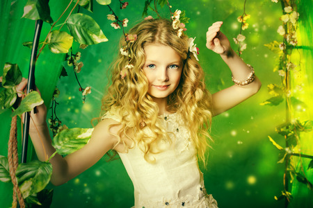 garden eel: Lovely girl in a lush white dress stands under a floral arch over green background.