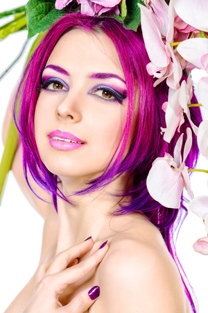 Beautiful woman among the flowers. Spring. Summer. Skin care. Hair coloring. Isolated over white. photo
