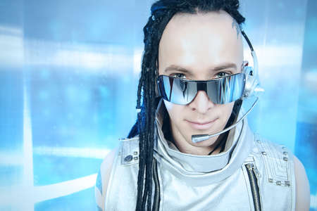 futuristic man: Eccentric futuristic man in silver costume and headset. Innovations and high technology. Rock artist.