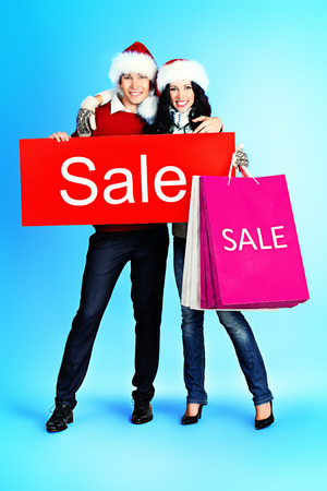 Full length portrait of a happy young people standing with a lot of shopping bags. Sale.  Stock Photo - 26145166
