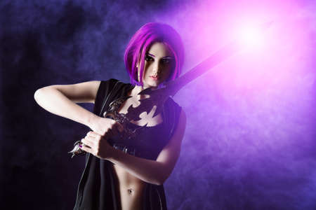 fantasy warrior: Beautiful girl warrior with a sword standing in fighting stance. Anime. Fantasy. Stock Photo