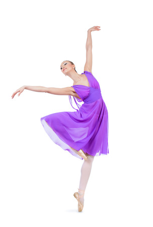 Beautiful elegant bellet dancer dancing at studio. Isolated over white. photo