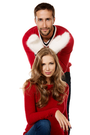 Happy young couple in warm winter clothing. Isolated over white. Stock Photo - 26737304