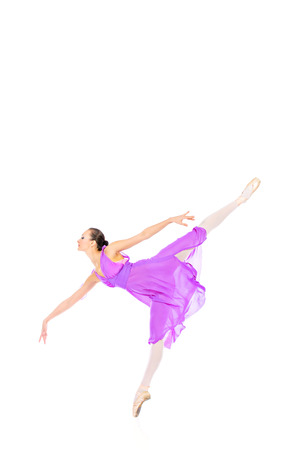 pointes: Beautiful elegant bellet dancer dancing at studio. Isolated over white. Stock Photo