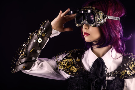 Girl in a stylized steampunk costume posing on a dark background. Anime. photo