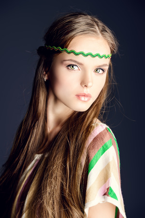 Beautiful girl with natural make-up and long hair. Hippie style. photo