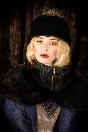 Gorgeous fashion model in a rich historical costume. Fur clothing. Vintage. Luxury style.  photo