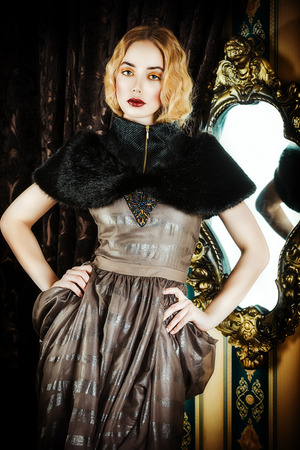 Beautiful fashion model in a rich historical dress. Vintage. Luxury style.  photo