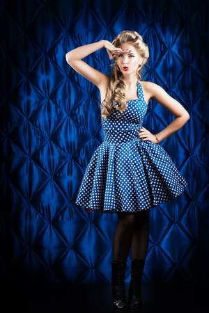 Full length portrait of a charming pin-up woman with retro hairstyle and make-up. Stock Photo - 27043697