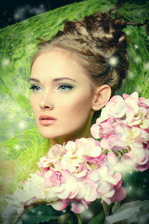 Portrait of a beautiful girl with flowers. Spring. Stock Photo - 27586187