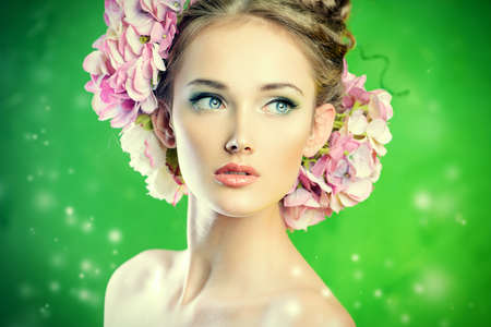 Beautiful girl with flowers in her hair. Spring. photo