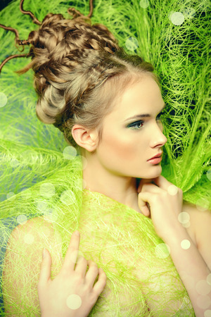 Fashion shot of a stunning female model with beautiful hairstyle. Spring beauty. photo