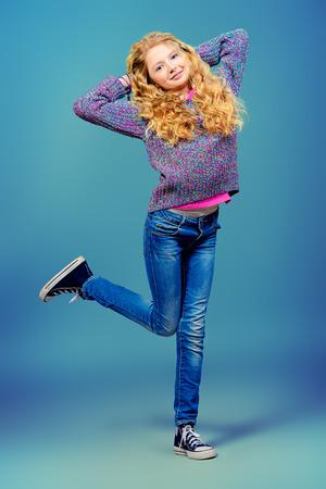 cheerfull: Full length portrait of a cheerful ten years girl. Stock Photo
