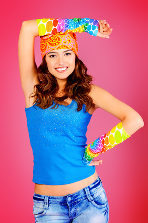 trendy girl: Cheerful teenager girl in bright casual clothes smiling at the camera.  Stock Photo