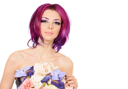 hair coloring: Beautiful woman among the flowers. Spring. Summer. Skin care. Hair coloring. Isolated over white.