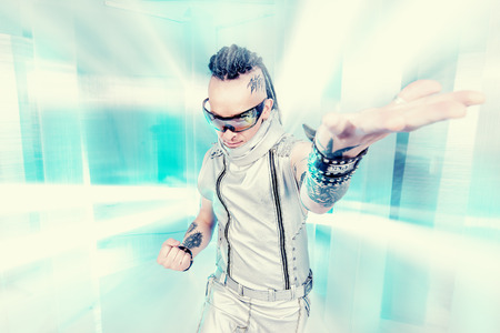 Portrait of the eccentric futuristic man in silver costume  Innovations and high technology  Rock artist  photo