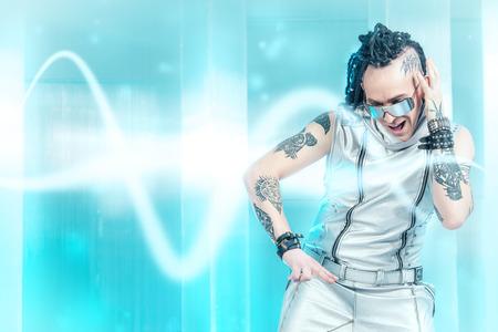 futuristic man: Portrait of the eccentric futuristic man in silver costume  Innovations and high technology  Rock artist