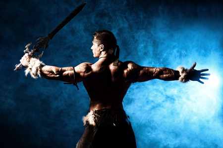 ancient warrior: Portrait of a handsome muscular ancient warrior with a sword.