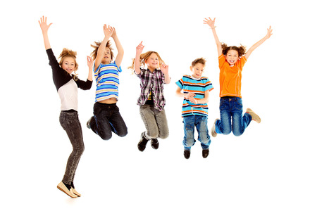 Cheerful boys and girls jumping for joy. Happiness. Isolated over white.