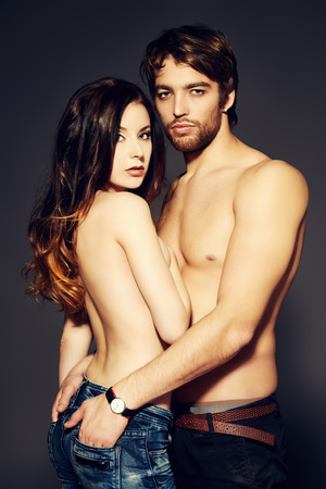 Beautiful passionate naked couple in love. Studio shot.  photo