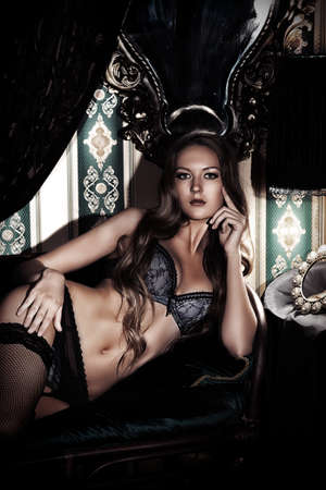 Attractive young woman alluring in sexy lingerie. Vintage interior.  photo