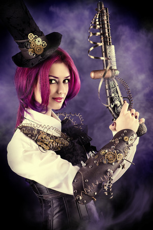 Girl in a stylized steampunk costume holding a gun. Anime. photo
