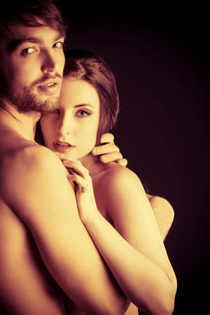 Beautiful naked couple in love in a tender embrace.